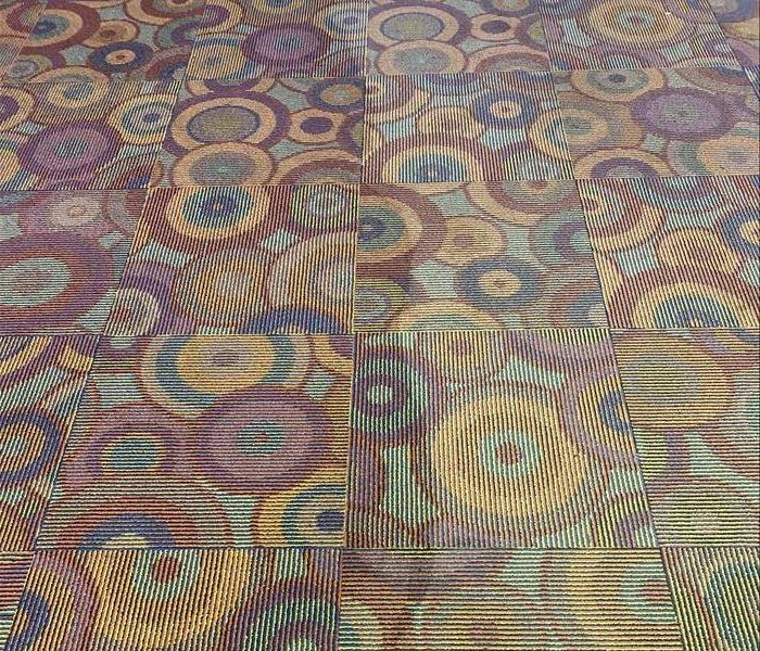 Side by side image of carpets before and after cleaning.