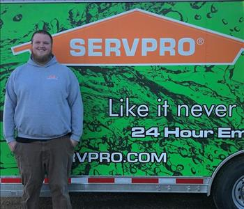Photo of SERVPRO of Spencer & Iowa Great Lakes Production Crew Member Marc Ketcham standing next to company trailer.