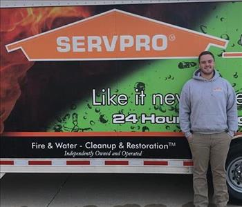 Photo of SERVPRO of Spencer & Iowa Great Lakes Production Crew Eric Wilkie standing next to company trailer.