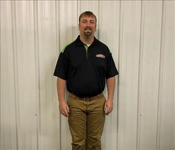 Photo of SERVPRO of Spencer & Iowa Great Lakes Production Crew Member Matthew Stafford standing in the SERVPRO shop.