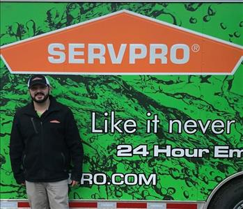 Photo of SERVPRO of Spencer & Iowa Great Lakes Production Manager Nick VonEhwegen standing next to company trailer.