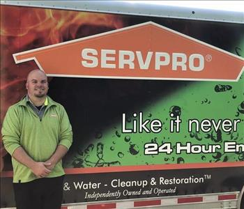 Photo of SERVPRO of Spencer & Iowa Great Lakes Sales & Marketing Manager Jason Lindsay standing next to company trailer.