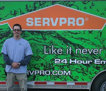 Photo of SERVPRO of Spencer & Iowa Great Lakes Reconstruction crew member Mario Janssen standing next to company trailer.