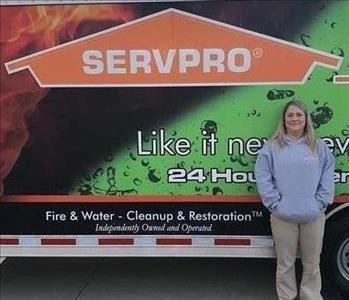 Photo of SERVPRO of Spencer & Iowa Great Lakes Production Crew Member Jennifer Meseck standing next to company trailer.