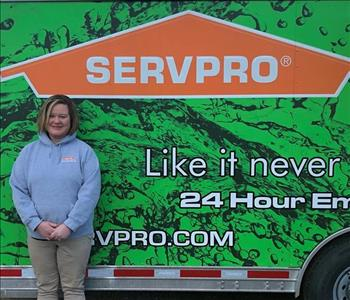 Photo of SERVPRO of Spencer & Iowa Great Lakes Production Crew Member Carol Bernardy standing next to company trailer.