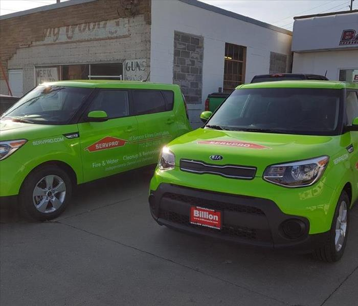 Photo of two of the SERVPRO of Spencer & Iowa Great Lakes marketing vehicles.