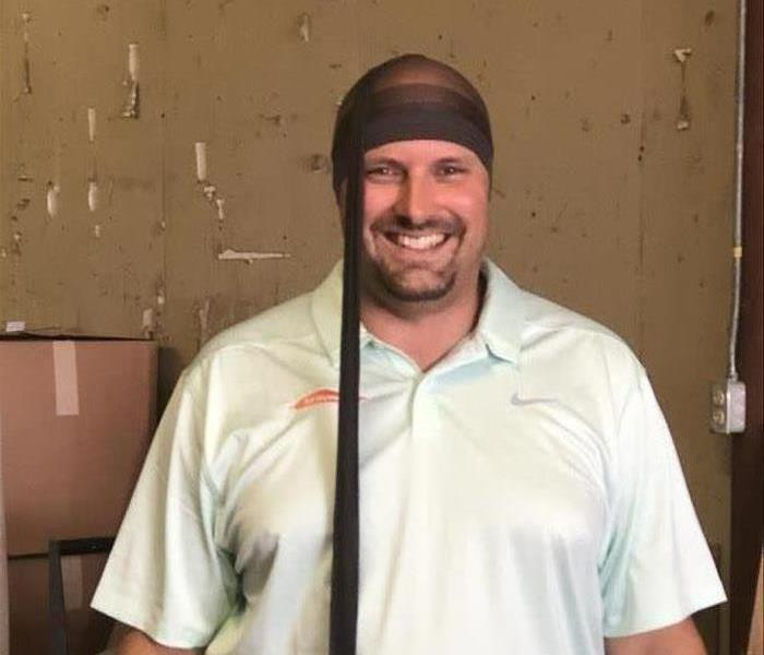 "Photo of owner Ryan Brooks with his nylon ""hat"" preparing for team building battle."