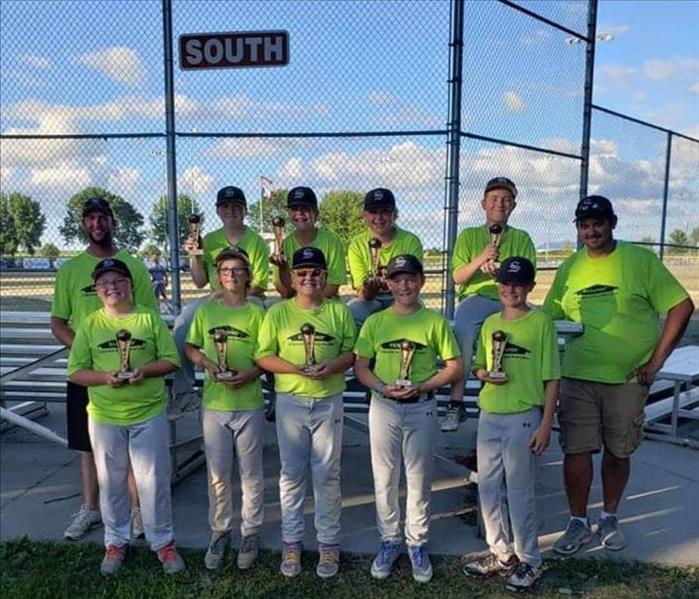 A team photo of our Spencer youth baseball team with their first place trophies.