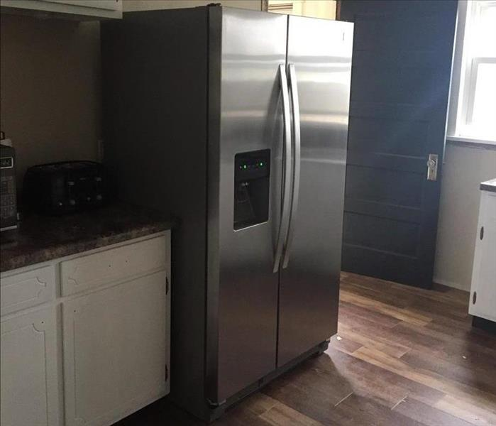 Refrigerator in a newly remodeled kitchen.